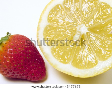 Lemon and strawberry close-up on a white background