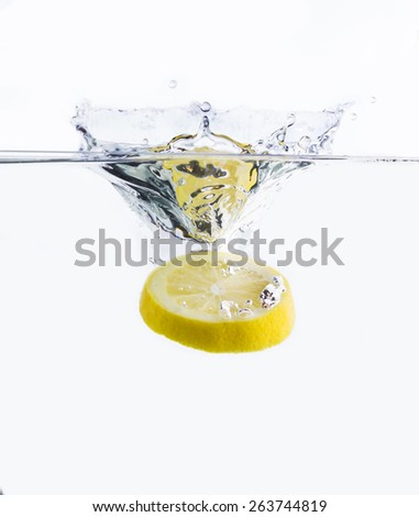 Lemon and water splash - stock photo