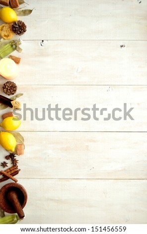 Lemon,aroma candle and aromatherapy supplies.on white wood background. - stock photo