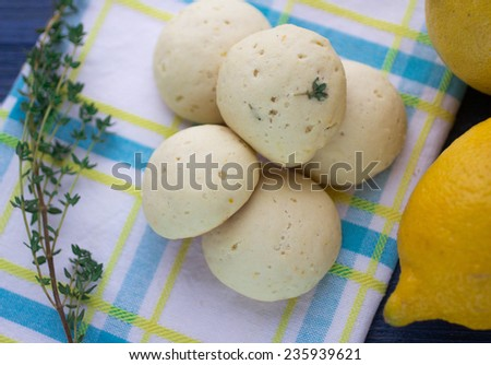 lemon biscuits on a white towel and thyme