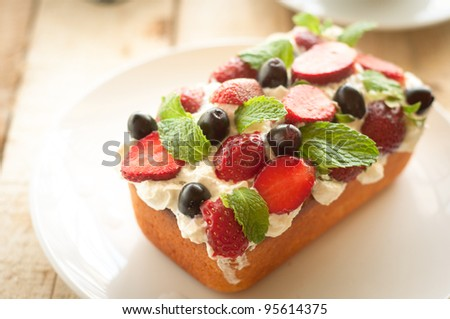 Lemon Cake topped with whipped cream, fresh fruits and mint 8 - stock photo