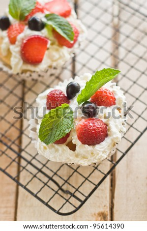 Lemon Cake topped with whipped cream, fresh fruits and mint 5 - stock photo