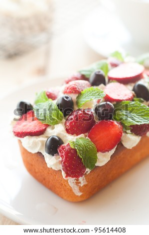 Lemon Cake topped with whipped cream, fresh fruits and mint 7 - stock photo