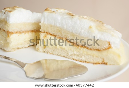 Lemon cake with meringue frosting - stock photo