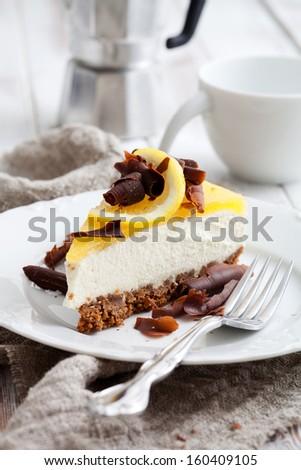 Lemon cheesecake with lemon slice and chocolate curls - stock photo
