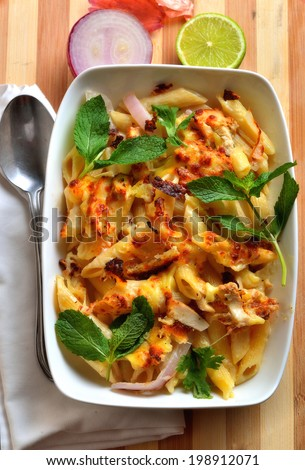 Lemon chicken pasta in a bowl on table - stock photo