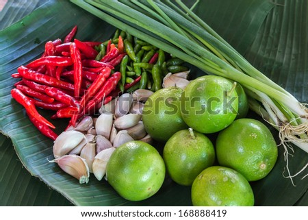lemon, chilli peppers, Garlic, Green onion - stock photo