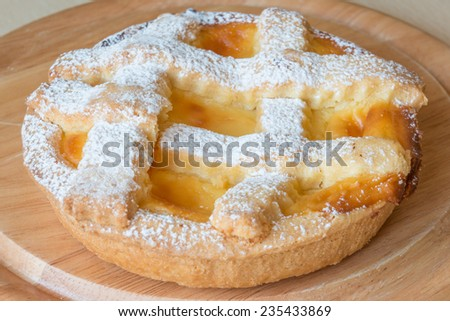 lemon citrus tart dessert on wooden plate - stock photo