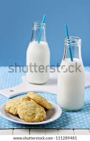 Lemon cornmeal cookies with a bottle of milk
