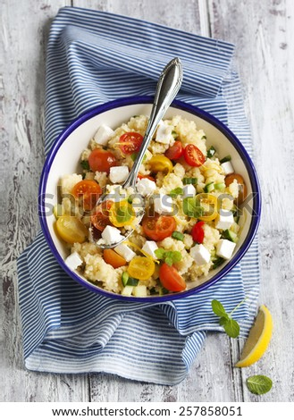 Lemon Couscous with Cherry Tomatoes, Mint and Feta. - stock photo