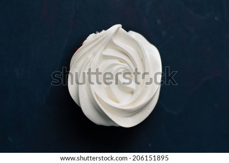 Lemon cupcakes with bilberry filled lemon curd and meringue frosting - stock photo