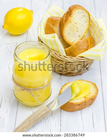 Lemon curd with lightly toasted baguette - stock photo