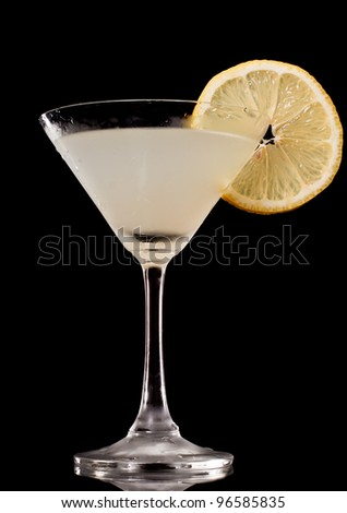 lemon drop martini isolated on a black background, view from the bottom up - stock photo