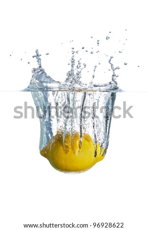 Lemon Dropping into Water - stock photo