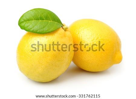 Lemon fruits with leaves on white - stock photo