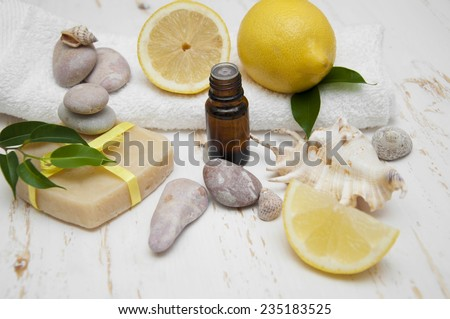 Lemon handmade soap with essential oils and lemon on a white background - stock photo