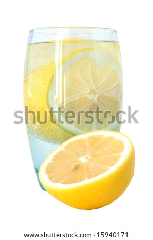 Lemon in glass with mineral water and ice.