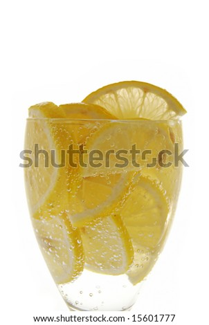 Lemon in glass with water on the white background - stock photo