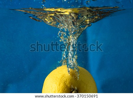 Lemon in water on a blue background