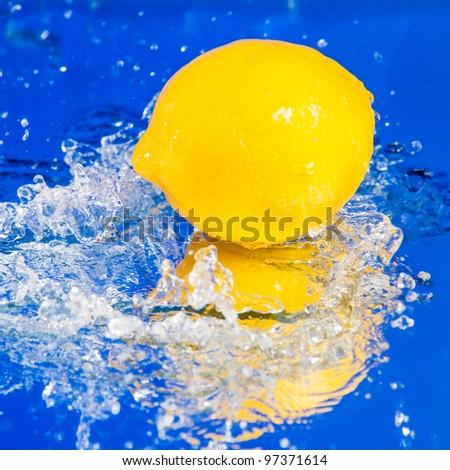 Lemon in water splash - stock photo