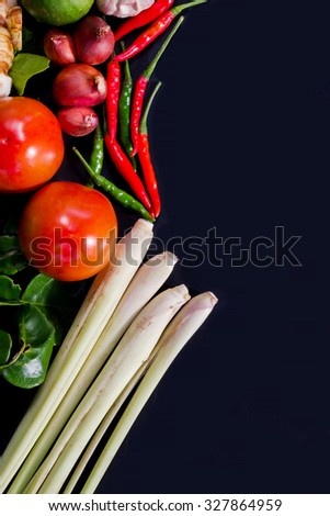 lemon, lemon grass, red chilli, and kaffir lime leaves on background. Overhead view. selective focus - stock photo