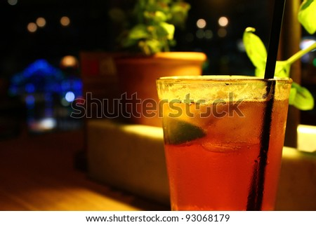 Lemon lime and bitters drink at a restaurant at night - stock photo