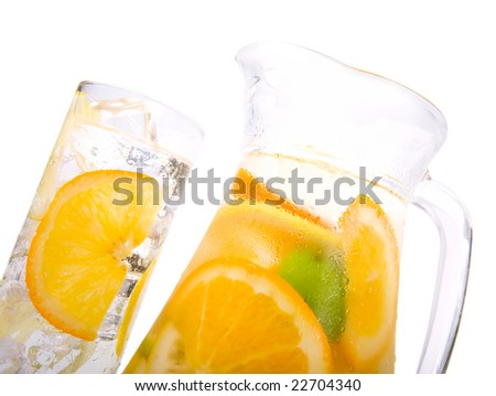Lemon, lime, orange and carafe with citrus ice water isolated on white