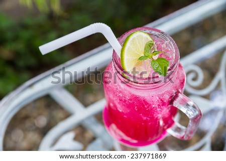 Lemon-lime soda in a glass of red. - stock photo
