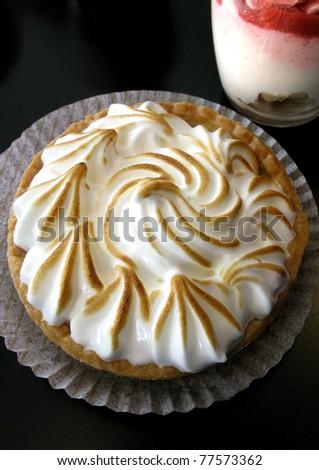 Lemon meringue pie and cream in a glass - stock photo