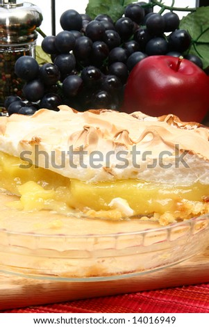 Lemon Meringue pie in kitchen or restaurant. - stock photo