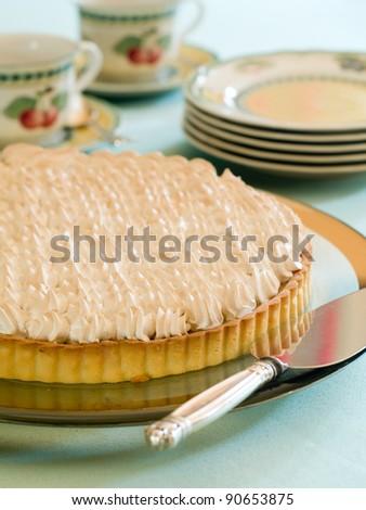Lemon meringue pie with in glass pie pan, selective focus - stock photo