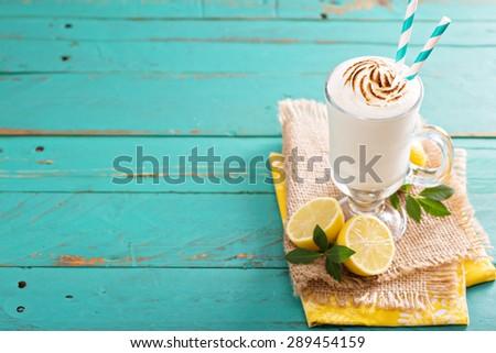 Lemon milkshake with browned meringue on top - stock photo