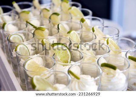 Lemon mousse verrine, french glass dessert - stock photo