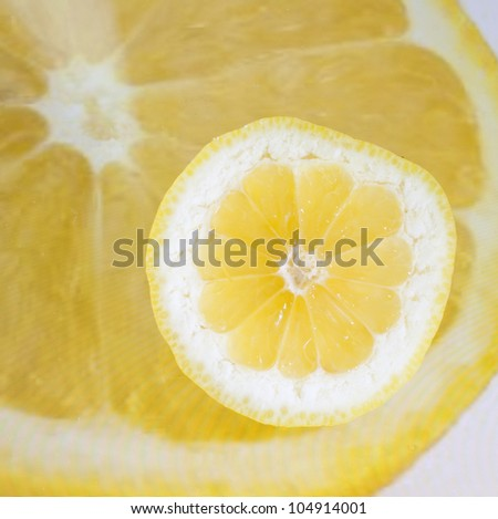 Lemon on a tablet displaying a lemon - stock photo