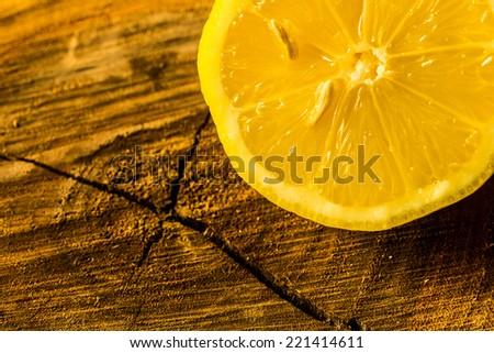 Lemon on a tree trunk cut  - stock photo