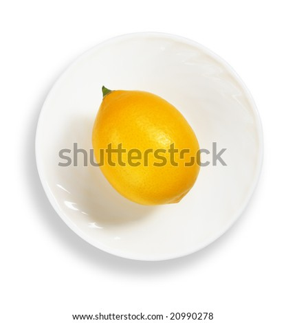 Lemon on the saucer - stock photo