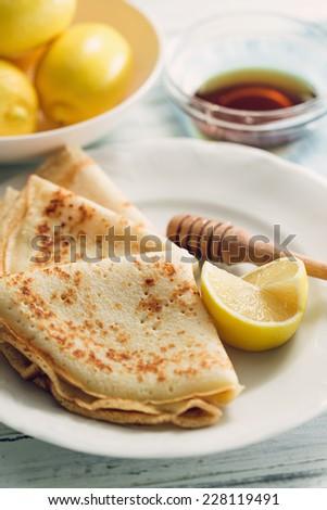 Lemon pancakes with honey - stock photo