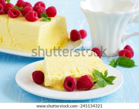 Lemon Semifreddo with raspberry. - stock photo