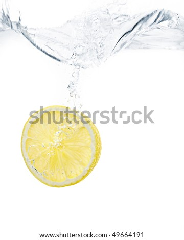 lemon slice splashing into water with white background