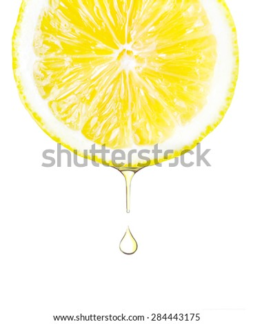 Lemon. Sliced lemon with a water dropping from it. Isolated on white.  - stock photo