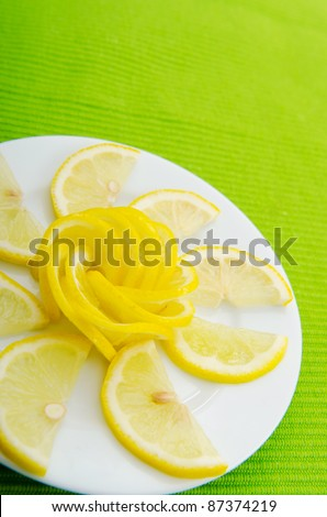 Lemon slices served in the plate - stock photo