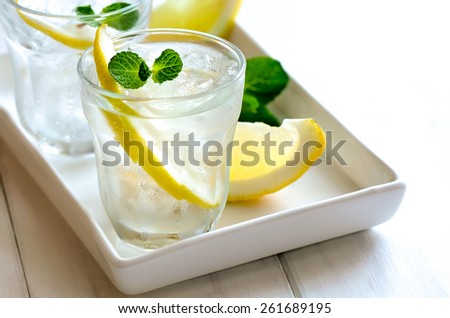 Lemon soda iced drink with mint, summer cooler - stock photo