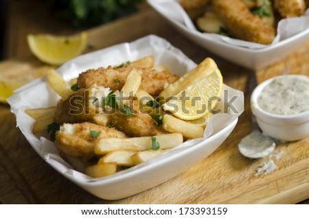 Lemon sole goujons with fries and tartar sauce - stock photo