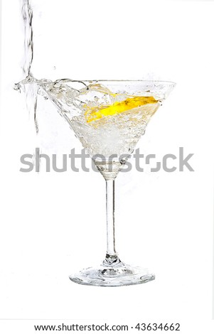 Lemon  splashing into a martini glass