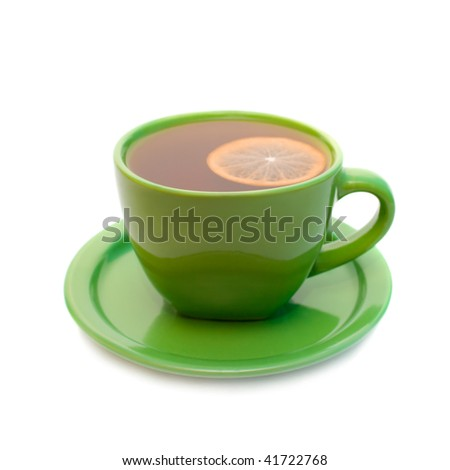 Lemon tea in green cup. Isolated on white background.