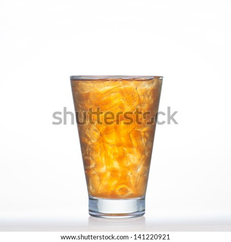 Lemon tea Thai drinks style with ice in glass isolated on white background