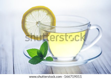 lemon tea with on wood table - stock photo