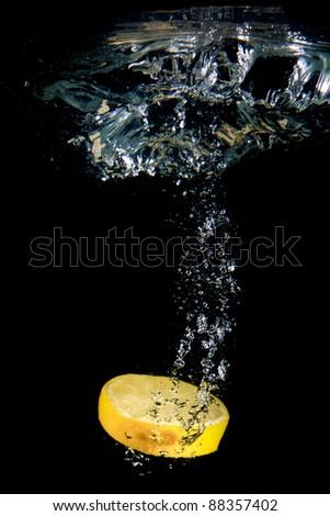 Lemon under water. Close up. Macro shot. - stock photo