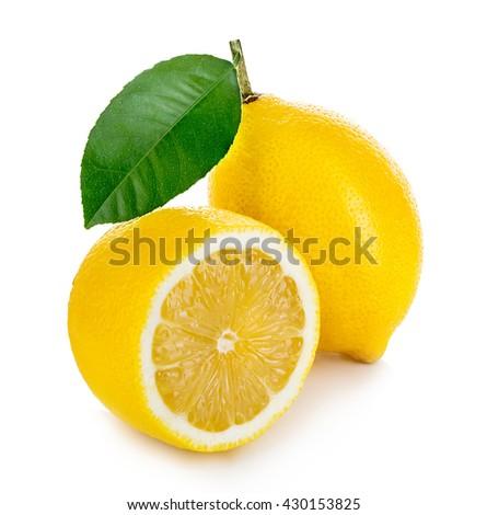 Lemon with green leaf isolated on white background - stock photo