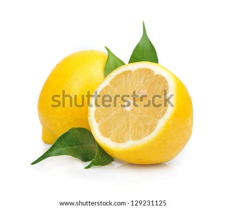 Lemon with leaves on white - stock photo